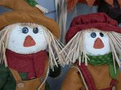 Two Small Autumn Scarecrows - Close Up poster
