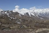 foto of mustang  - Landscape of Muktinath village in lower Mustang District Nepal. This photo was shot in early morning. Area was cover by snow. - JPG