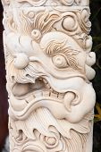 foto of dragon head  - Carved marble pink column with dragon head - JPG