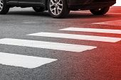 stock photo of pedestrian crossing  - Pedestrian crossing road marking and moving car photo with red gradient tonal filter selective focus and shallow DOF - JPG