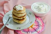 pic of frizzle  - Delicious homemade pancakes with sour cream on a pink background - JPG