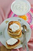 picture of frizzle  - Delicious homemade pancakes with sour cream on a pink background - JPG
