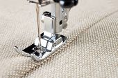 picture of sewing  - sewing machine makes a seam on fabric - JPG