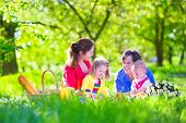 pic of little young child children girl toddler  - Young family with kids having picnic outdoors - JPG