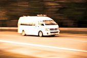 foto of ambulance  - blurry Ambulance high speed in motion driving on the road - JPG