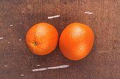 stock photo of bittersweet  - Fresh Ripe Sweet Tropical Orange Fruit on Rustic Grunge Brown Wood Background Top View - JPG