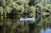 image of canoe boat man  - View of the young man rowing in a canoe - JPG