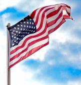 foto of flag pole  - Close up view of Flag USA over blue sky background - JPG
