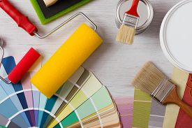 picture of reconstruction  - Painter and decorator work table with house project color swatches painting roller and paint brushes top view - JPG