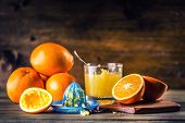 Постер, плакат: Fresh oranges Pressed orange manual method Oranges and sliced oranges with juice and