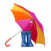 rubber boots and a colorful umbrella