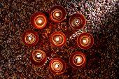 Votive Candles Burning In Meditation Spiritual Circle