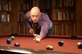 foto of hustler  - Handsome man playing pool billiards in home - JPG