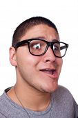 stock photo of dorky  - A goofy man wearing trendy nerd glasses isolated over white with a funny expression on his face - JPG