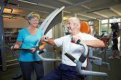 Fitness Trainer Explaining Rowing Machine