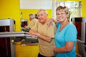 Elderly Couple In Gym