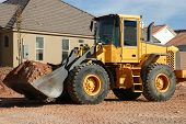 Front End Loader On House Lot