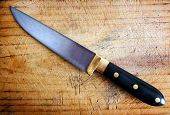picture of cutting board  - Close up image of kitchen knife with cutting board - JPG