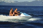 stock photo of jet-ski  - seadoo water bike with two riders - JPG