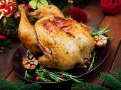 Baked Turkey Or Chicken. The Christmas Table Is Served With A Turkey, Decorated With Bright Tinsel A poster