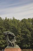 stock photo of chopin  - Monument of Chopin in a park in the middle of Warsaw - JPG