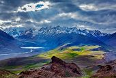 Himalayan landscape near Chandra Tal lake with sun rays coming through clouds. Himachal Pradesh, Ind poster