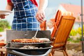 image of bbq party  - Happy family having a barbecue in summer - JPG
