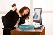 Angry Business Woman Expressing Rage At Her Desk In The Office poster