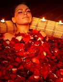 picture of beauty parlour  - Beautiful girl in jacuzzi with rose petal and candle - JPG