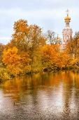 Orthodox Renovated Church Over Autumn River poster