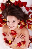 Young beautiful woman on massage table in beauty spa.