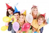 picture of party people  - Group of young people in party hat holding balloon - JPG
