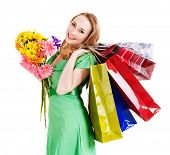 Happy young woman with shopping bag. Isolated.