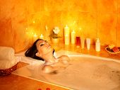 stock photo of sauna woman  - Young woman take bubble  bath - JPG