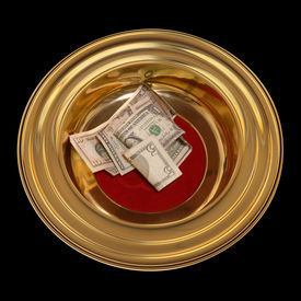 foto of stewardship  - Church offering plate with some currency in it - JPG