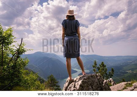 poster of Traveling outdoor hiking walking nature. Traveling in nature. travel outdoor backpacking nature. Nature. Travel. Traveling. Sunset. Hiking. Nature and beautiful mountain view. Travel landscape nature.