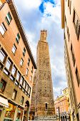 Two Medieval Towers Of Bologna (le Due Torri): Asinelli Tower And Garisenda Tower On Piazza Di Porta poster
