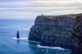 Iconic Cliffs Of Moher In Wild Atlantic Way With Ruins Of Tower On Edge Of High Cliff, Beautiful Dra poster