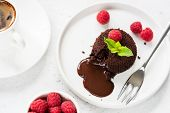 Chocolate Lava Cake Or Molten Core Cake With Raspberries On White Plate poster