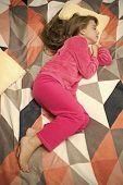 Comfortable Pajamas For Relax. Girl Little Kid Wear Soft Cute Pajamas While Relaxing On Bed. Tired B poster