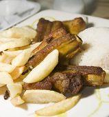 Chuletas de cerdo costillas Plato Del Dia de La Candelaria Bogota Colombia