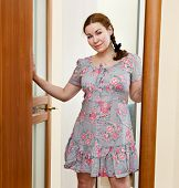 Portrait Of Young Caucasian Female In Dress Standing In Domestic Room poster