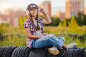 Young Girl Listening Music Headphones, Urban Street Style, Outdoor Street Style Hipster Dj Woman In  poster