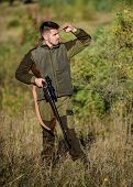 Hunting Permit. Bearded Serious Hunter Spend Leisure Hunting. Hunter Hold Rifle. Hunting Is Brutal M poster