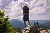 Traveler Girl On Mountain Cliff In Vacation. Young Girl Traveler In Vacation. Traveler Look To Mount poster