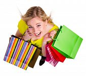 Beautiful blond girl with shopping bags, isolated on white background