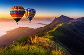 Landscape Of Morning Fog And Mountains With Hot Air Balloons At Sunrise. poster