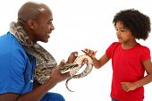 Black Male Vet Holding Snake While A Young Child Looks On