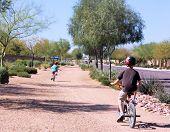 Kids Riding Bikes Wearing Helmets