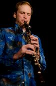 VANCOUVER, CANADA - FEBRUARY 9: jazz band Tambura Rasa. Lucas Moore (Turkish clarinet) on the stage